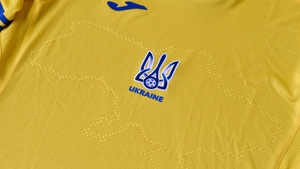 The uniforms feature the silhouette of Ukraine that includes Russia-annexed Crimea and the separatist-controlled regions of Donetsk and Lugansk as well as slogans