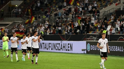 Toni Kroos leads the German players on a farewell lap of honour at Merkur Spiel-Arena in Duesseldorf