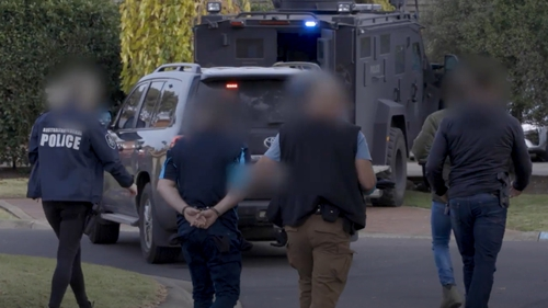Victoria Police make arrests in Sydenham, Victoria, Australia, as part of Operation Ironside