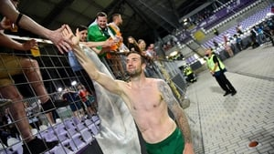 Shane Duffy greets some of the Ireland supporters inside Szusza Ferenc Stadion