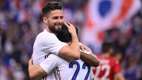 Olivier Giroud (L) rose off the bench to score twice