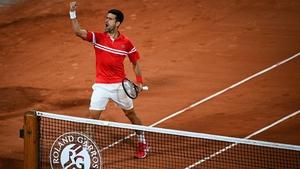 An animated Novak Djokovic celebrates his win on Court Philippe Chatrier