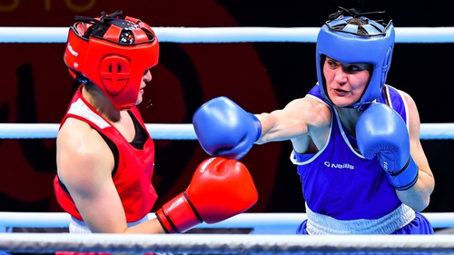 Former world champion Kellie Harrington (R) will compete at the Olympics for the first time