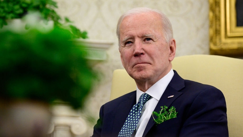 Joe Biden listens during a virtual meeting with Taoiseach Micheál Martin in the Oval Office of the White House on St Patrick's Day