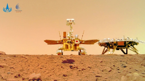 A handout photo made available by the China National Space Administration shows Zhurong next to the landing platform