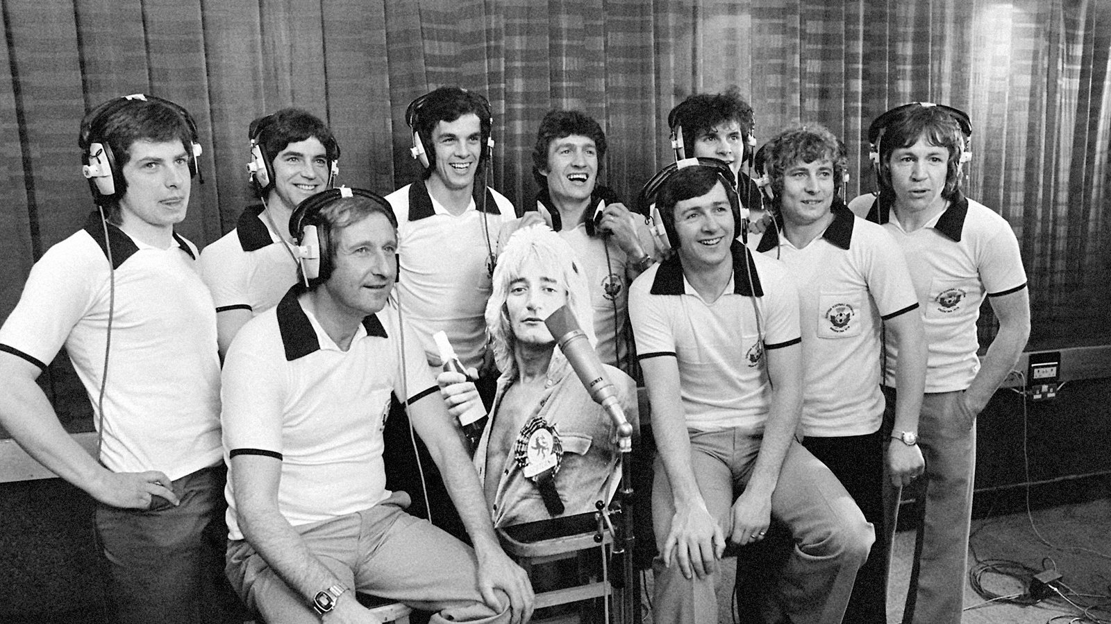Image - Ally MacLeod (second from left) with Scotland squad and a cardboard cutout of Rod Stewart ahead of 1978 World Cup