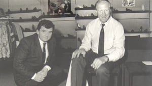 Founder Nevil O'Sullivan serves one of the shops most famous customers at Nevil's Shoes in Limerick