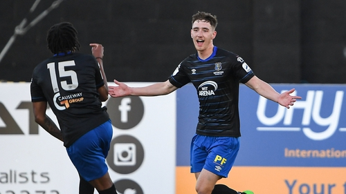 John Martin celebrates scoring his second goal and Waterford's third of the evening at Oriel Park