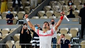 Novak Djokovic celebrates his rare feat