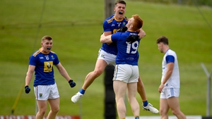 Wicklow players, from left, Darragh Fitzgerald, JP Hurley and Chris O'Brien celebrate at the final whistle