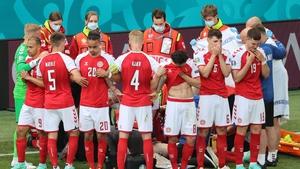 Danish players shield Eriksen as he receives treatment