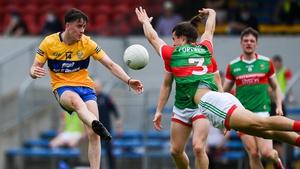 Oisín Mullin blocks a shot from Joe McGann