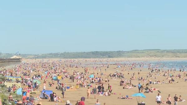 People enjoying the seaside in Tramore, Co Waterford