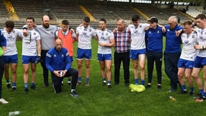 Monaghan players and management after surving for another year in the top flight