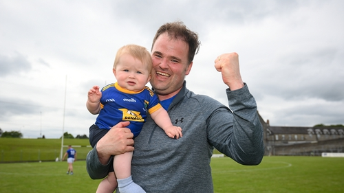 Wicklow manager Davy Burke and his eight-month-old son Shea celebrating yesterday