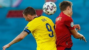 Sweden's Marcus Berg heads the ball with Spanish defender Diego Llorente