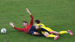 Alvaro Morata and Albin Ekdal tangle during the Group E clash in Seville