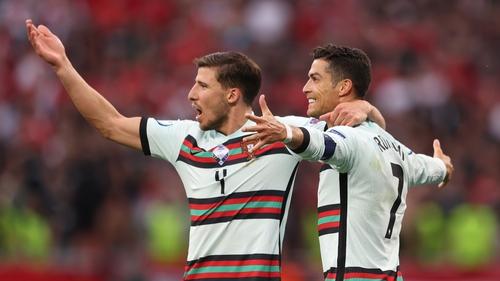 Cristiano Ronaldo celebrates with Ruben Dias after the third goal