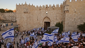 Israelis wave flags outside Damascus Gate (Getty Images)