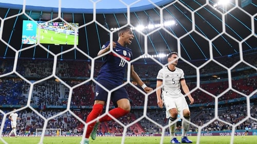 Kylian Mbappe of France celebrates their side's first goal, an own goal by Mats Hummels