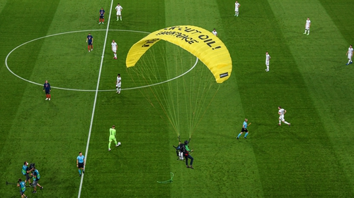 Debris fell on the pitch when parachutist got tangled in wires of overhead camera