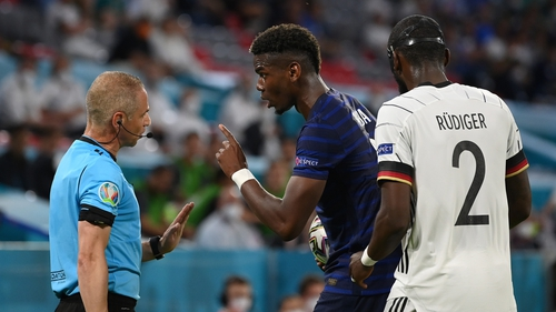Pogba speaks with assistant referee, Juan Carlos Yuste after the incident