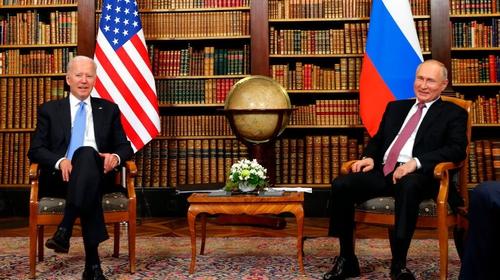 Joe Biden (L) and Vladimir Putin meet at the start of the US-Russia summit at Villa La Grange in Geneva