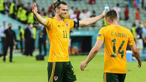 Gareth Bale (L) celebrates with Connor Roberts