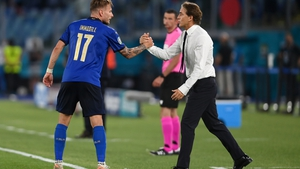 Ciro Immobile is congratulated by Roberto Mancini after scoring Italy's third goal against Switzerland