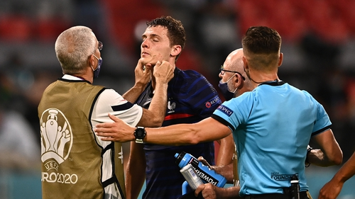 Pavard receives medical treatment after the incident