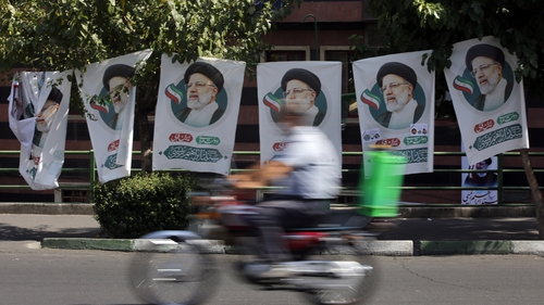 Posters of Iranian presidential candidate Ebrahim Raisi in a street in Tehran