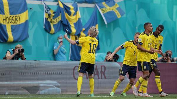 Emil Forsberg celebrates after scoring Sweden's goal from the spot