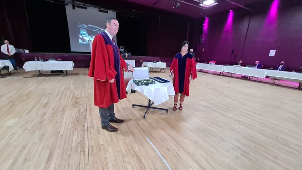 Mike Cubbard handed over the chains of office to Ms Connolly at Leisureland today (Pic - Galway City Council)