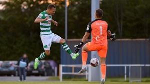 Burke scores the Hoops' third goal past Waterford goalkeeper Brian Murphy