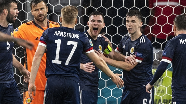 Andrew Robertson (centre) celebrates a late clearance as Scotland claimed a deserved draw at Wembley