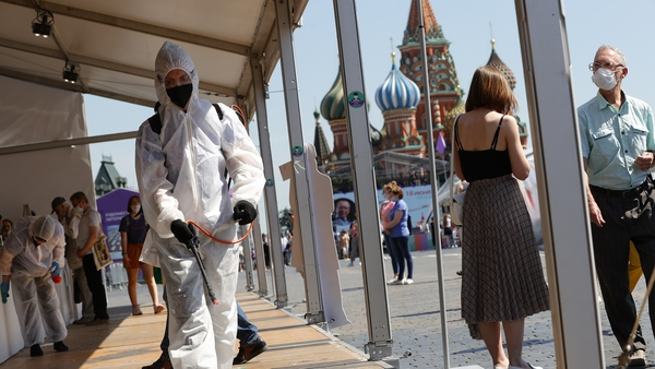 Workers disinfectant a book fair being held in Moscow