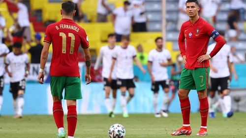 Cristiano Ronaldo (R) and Portugal have work to do to make the knockout stages