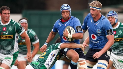 Gio Aplon is tackled by Benetton's Marco Zanon
