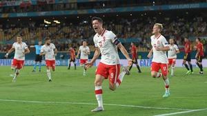 Robert Lewandowski headed home a second half equalizer to keep Poland's hopes of progressing alive