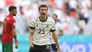 Thomas Müller celebrates Germany's third goal against Portugal