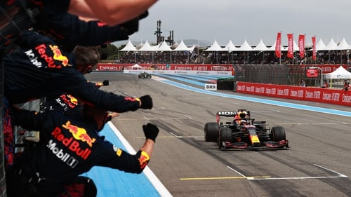 Max Verstappen is cheered on by his team