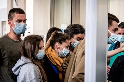 Valerie Bacot (yellow scarf) arrives flanked by her children to the Chalon-sur-Saone Courthouse, central-eastern France, prior to the opening hearing of her trial on charges of murdering her stepfather turned husband
