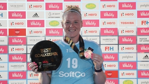 McFerran with her silver medal and her Best Goalkeeper of the Tournament Award from the 2018 World Cup