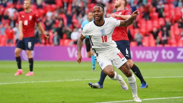 Raheem Sterling celebrates after scoring England's winner
