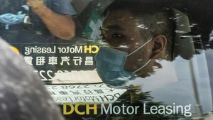 Tong Ying-kit is accused of driving his motorcycle into a group of police officers