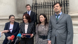 Rebecca Price (2R) and Patrick Kiely (R) outside the High Court