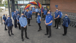 Aldi's Douglas store staff ahead of welcoming their first customer at the new store in Co Cork today
