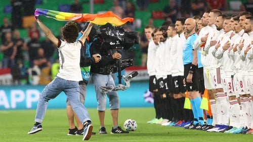 A pitch invader waved a rainbow flag as Hungary and Germany lined out on Wednesday
