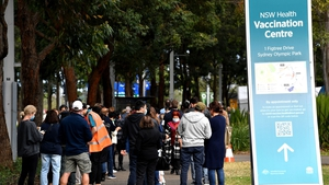 People queue outside a vaccination centre in Sydney