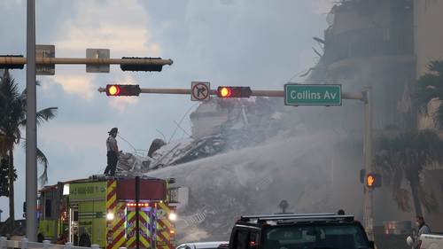 Hundreds of fire and rescue workers scoured through tonnes of rubble after the 12-storey residential building partially collapsed